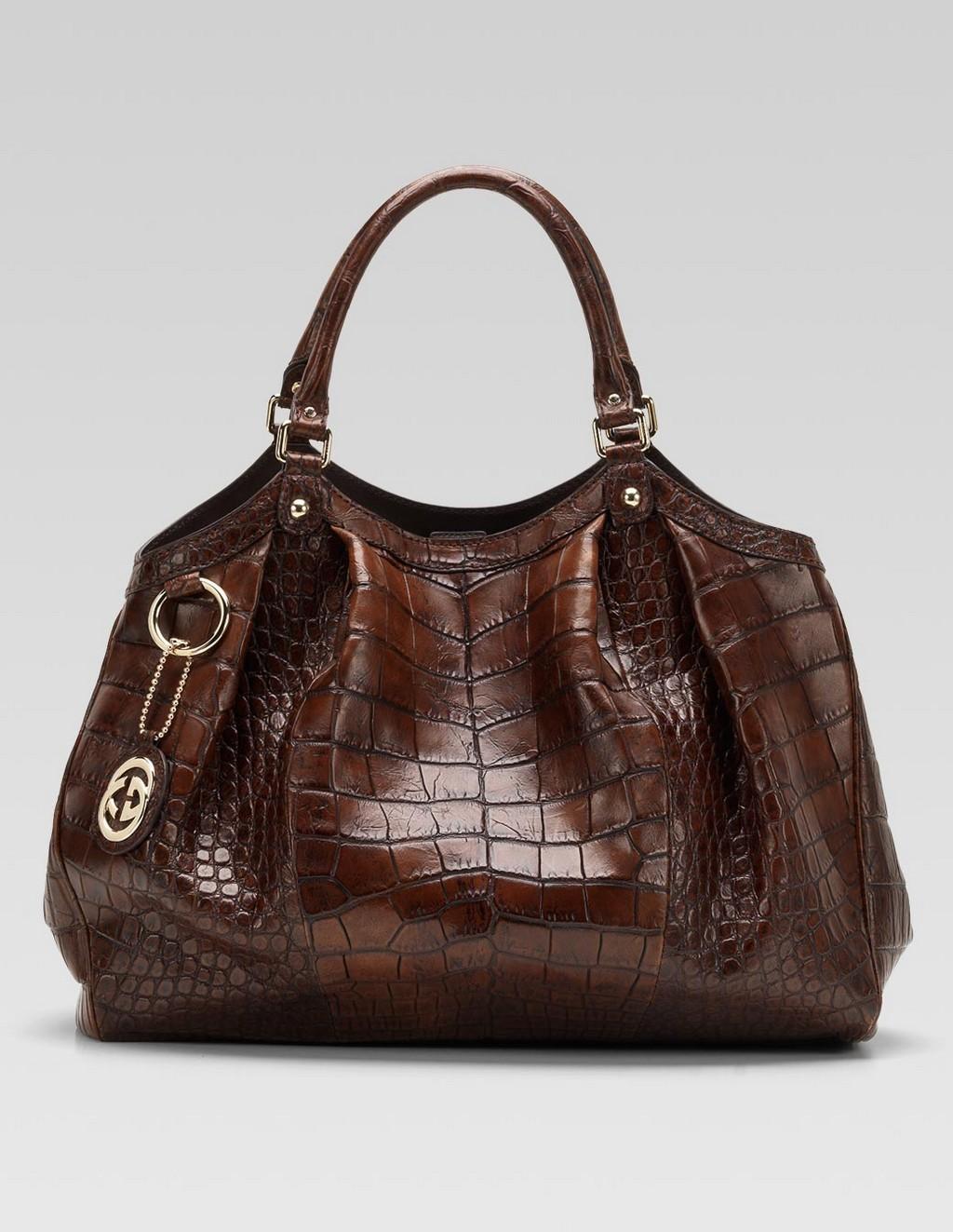 unique handbag purple designer handbag juicy couture handbag carolina herrera handbag